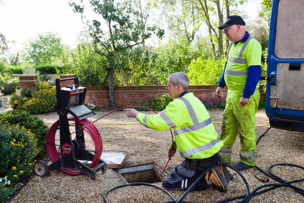stock-photo-buckingham-uk-october-a-drain-cleaning-company-chec-min
