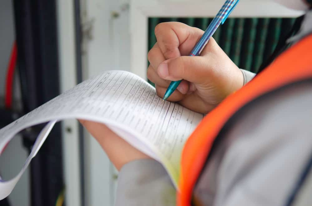 stock-photo-engineer-wear-safety-equipment-write-and-record-inspection-report-worker-write-maintenance-check-1718328052-min