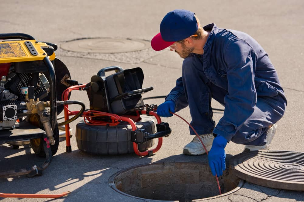 stock-photo-plumber-prepares-to-fix-the-problem-in-the-sewer-with-portable-camera-for-pipe-inspection-and-other-1889560633-min