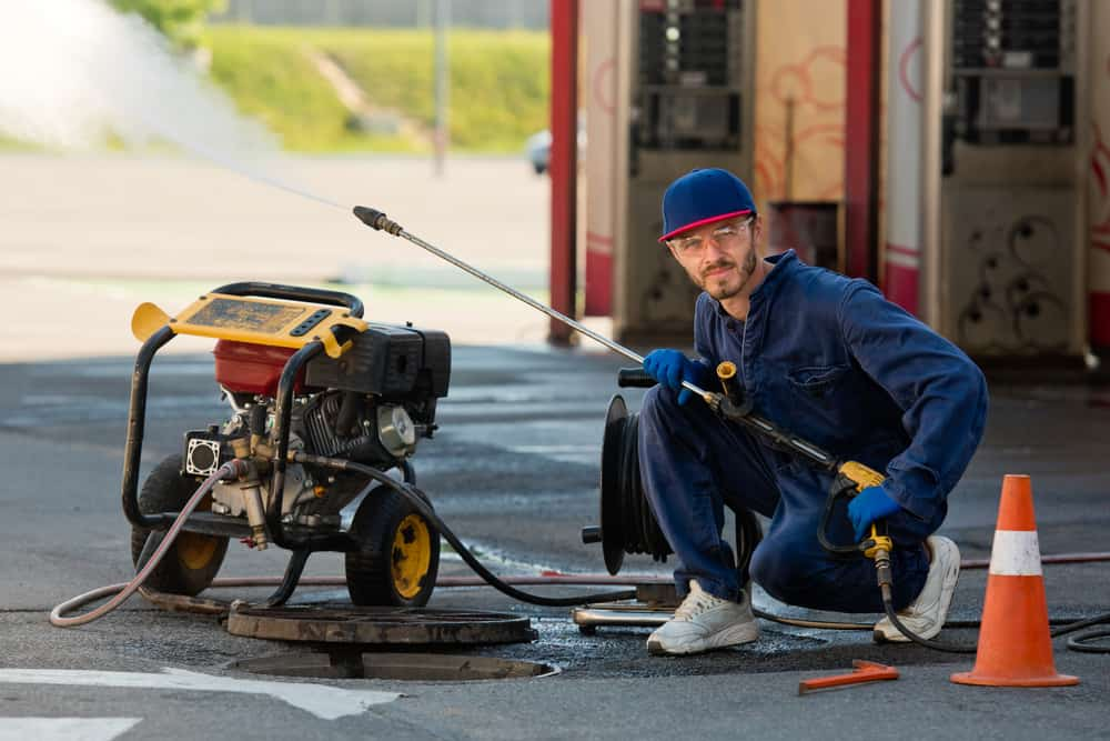 stock-photo-the-plumber-prepares-to-fix-the-problem-in-the-sewer-repair-work-on-troubleshooting-1890849310-min