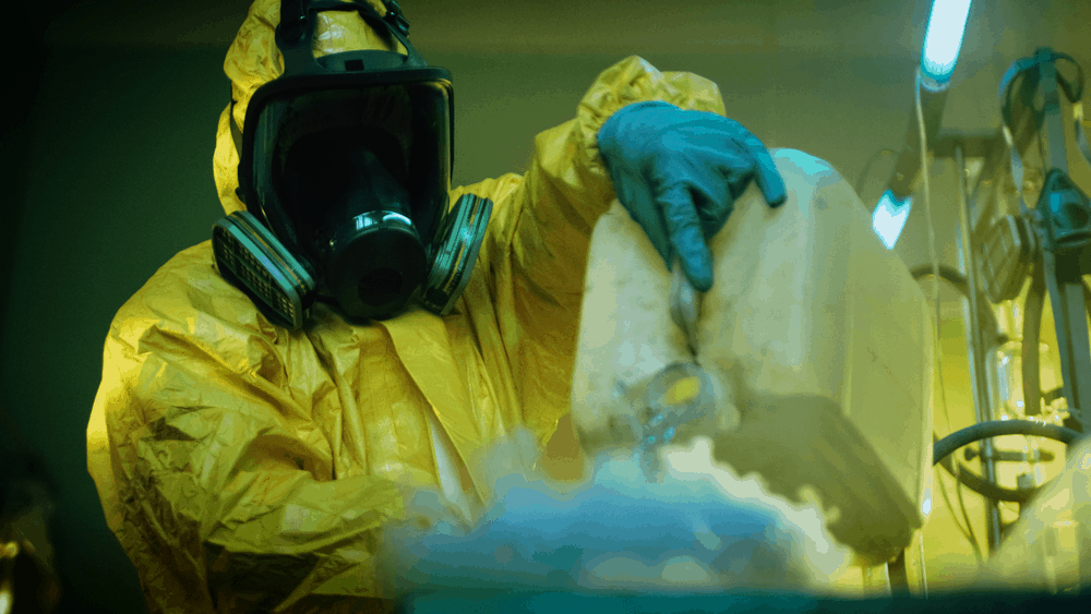 stock-photo-in-the-underground-drug-laboratory-clandestine-chemist-wearing-protective-mask-and-coverall-mixes-729061210