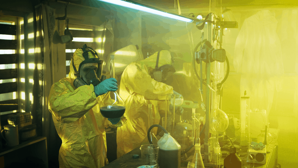stock-photo-in-the-underground-laboratory-two-clandestine-chemists-cook-drugs-they-wear-masks-and-coveralls-729061102